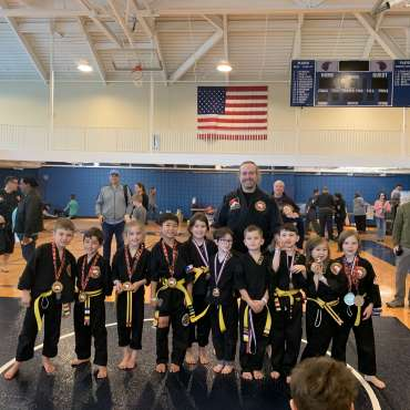 Yellow belt grappling medal winners at the Kids Kenpo Martial Arts tournament at Episcopal School of Dallas with Adam Strickland