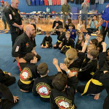 Shihan Mike addressing the yellow belts at the Kids Kenpo Martial Arts tournament at Episcopal School of Dallas