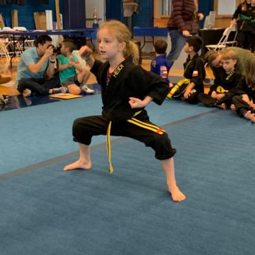 Heidi performing kata at the Kids Kenpo Martial Arts tournament at Episcopal School of Dallas