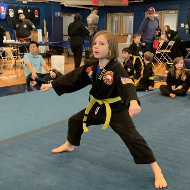 Maeve performing kata at the Kids Kenpo Martial Arts tournament at Episcopal School of Dallas