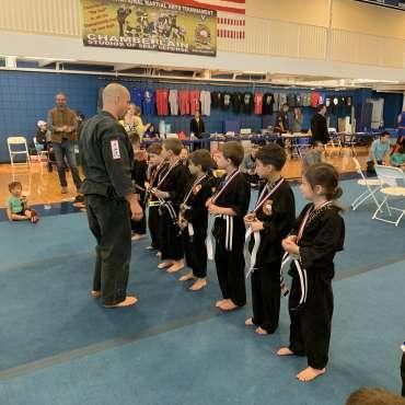 Brett congratulating the winners at the Kids Kenpo Martial Arts tournament at Episcopal School of Dallas