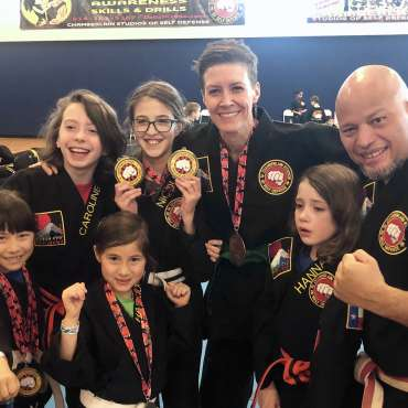 Shihan Rollend, Emily and their students at the Kids Kenpo Martial Arts tournament at Episcopal School of Dallas