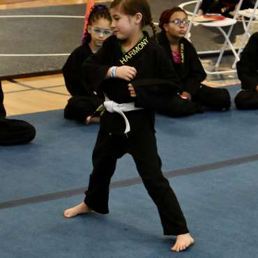 Harmony doing kata at the Kids Kenpo Martial Arts tournament at Episcopal School of Dallas