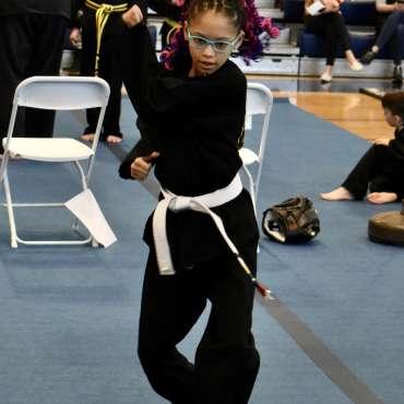 Performing kata at the Kids Kenpo Martial Arts tournament at Episcopal School of Dallas
