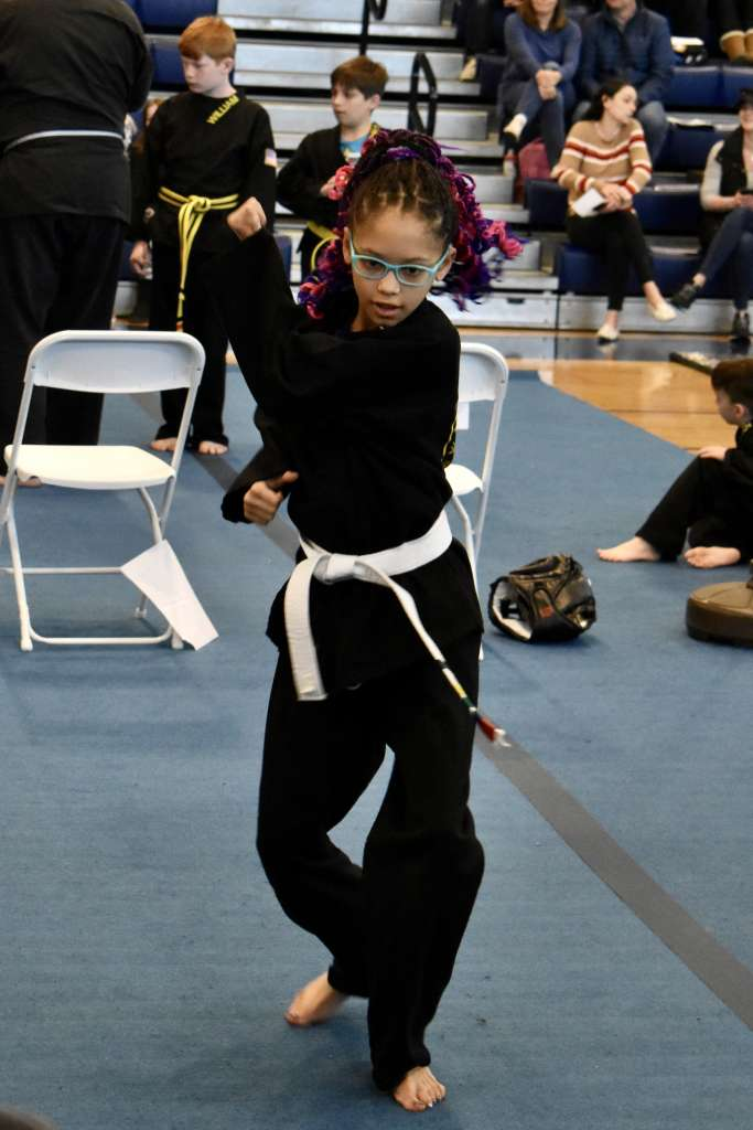 Performing kata at the Kids Kenpo Martial Arts tournament at Episcopal School of Dallas