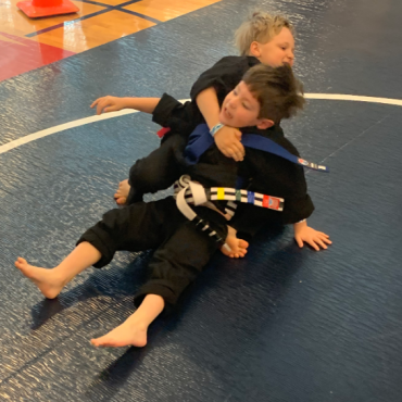 Grappling at the Kids Kenpo Martial Arts tournament at Episcopal School of Dallas