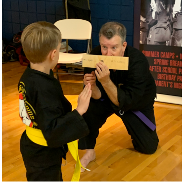 Board Breaking at the Kids Kenpo Martial Arts tournament at Episcopal School of Dallas