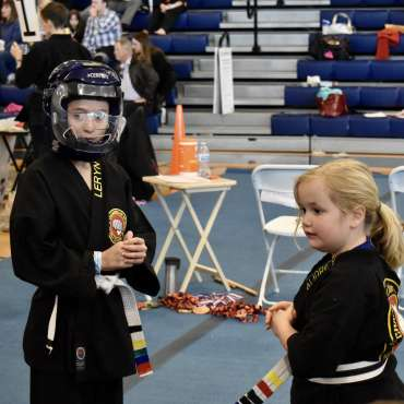 Leryn and Audrey in the self-defense division the Kids Kenpo Martial Arts tournament at Episcopal School of Dallas