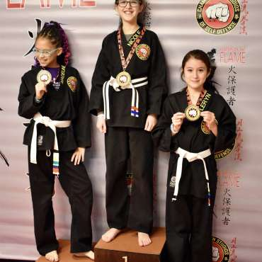 Medal winners at the Kids Kenpo Martial Arts tournament at Episcopal School of Dallas
