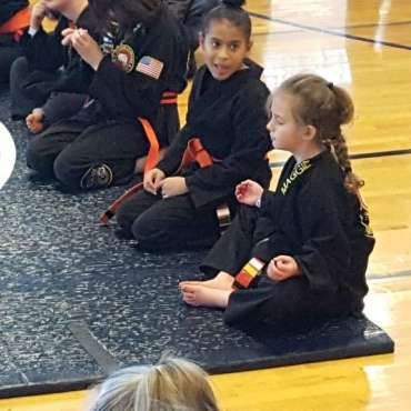 Maggie meditating at the Kids Kenpo Martial Arts tournament at Episcopal School of Dallas