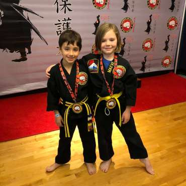Ben and Maeve after winning medals at the Kids Kenpo Martial Arts tournament at Episcopal School of Dallas