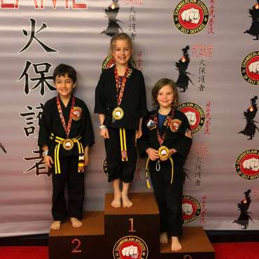 Heidi, Ben and Maeve after winning medals at the Kids Kenpo Martial Arts tournament at Episcopal School of Dallas