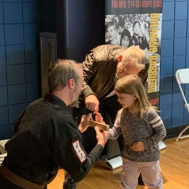 Breaking a board at the Kids Kenpo Martial Arts tournament at Episcopal School of Dallas