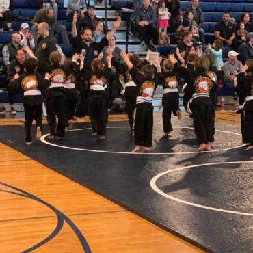Sensei Kory leading warmups during the Kids Kenpo Martial Arts tournament at Episcopal School of Dallas