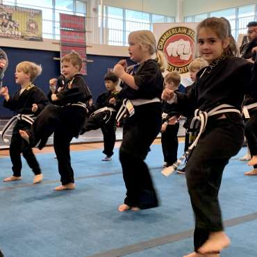 Warmups at the Kids Kenpo Martial Arts tournament at Episcopal School of Dallas