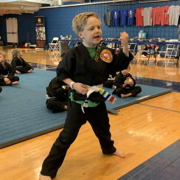 Preston performing Blocking Form 1 at the Kids Kenpo Martial Arts tournament at Episcopal School of Dallas