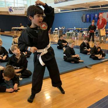 Blocking Form 1 at the Kids Kenpo Martial Arts tournament at Episcopal School of Dallas