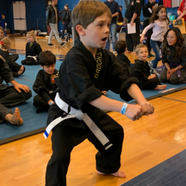 Broooks performing Blocking Form 1 at the Kids Kenpo Martial Arts tournament at Episcopal School of Dallas