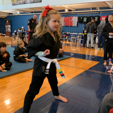Performing Blocking Form 1 at the Kids Kenpo Martial Arts tournament at Episcopal School of Dallas