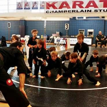 Sensei Kory leading warmups at the Kids Kenpo Martial Arts tournament at Episcopal School of Dallas