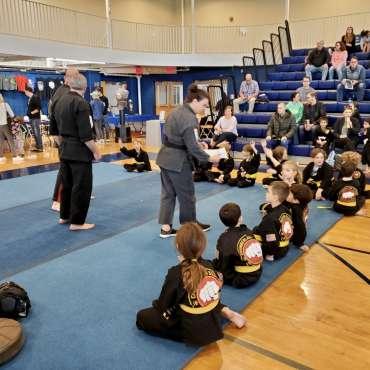 Sensei Trish taking attendance at the Kids Kenpo Martial Arts tournament at Episcopal School of Dallas