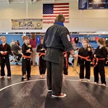 Sensei Glenn addressing grapplers at the Kids Kenpo Martial Arts tournament at Episcopal School of Dallas